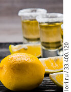 Купить «Tequila drink served in glasses with lime and salt», фото № 33400120, снято 18 сентября 2017 г. (c) Elnur / Фотобанк Лори