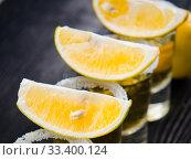 Купить «Tequila drink served in glasses with lime and salt», фото № 33400124, снято 18 сентября 2017 г. (c) Elnur / Фотобанк Лори