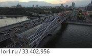 Купить «A transport bridge over a city river», видеоролик № 33402956, снято 10 июля 2020 г. (c) Данил Руденко / Фотобанк Лори