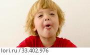 Купить «Playful child showing tongue», видеоролик № 33402976, снято 8 июля 2019 г. (c) Ekaterina Demidova / Фотобанк Лори
