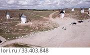 Купить «Picturesque rural landscape of Campo de Criptana with traditional windmills in sunny day, Spain», видеоролик № 33403848, снято 23 апреля 2019 г. (c) Яков Филимонов / Фотобанк Лори
