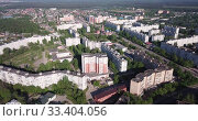 Купить «Picturesque aerial view of cityscape of Russian city of Orekhovo-Zuyevo located on two banks of Klyazma River in sunny day», видеоролик № 33404056, снято 12 мая 2019 г. (c) Яков Филимонов / Фотобанк Лори