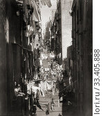 Купить «Via Pallonetto S. Lucia in Naples, Italy, in the late 19th century. After a work by German photographer Giorgio Sommer, 1834 -1914.», фото № 33405888, снято 21 февраля 2020 г. (c) age Fotostock / Фотобанк Лори