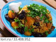 Купить «Pilaw with mutton? dried fruits and garlic», фото № 33408952, снято 29 мая 2020 г. (c) Яков Филимонов / Фотобанк Лори