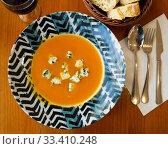 Купить «Boiled vegetarian carrot cream soup served with gorgonzola», фото № 33410248, снято 7 апреля 2020 г. (c) Яков Филимонов / Фотобанк Лори