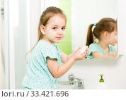 Купить «Little girl washing hands and showing soapy palms», фото № 33421696, снято 3 июня 2020 г. (c) Оксана Кузьмина / Фотобанк Лори