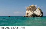 Купить «Aphrodite's Stone on Petra tou Romiou or Aphrodite Rock Beach, one of the main attractions and landmarks of Cyprus island.», видеоролик № 33421740, снято 17 марта 2020 г. (c) Serg Zastavkin / Фотобанк Лори