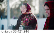 Russian folklore - russian woman in a scarf is clapping her hands. Стоковое фото, фотограф Константин Шишкин / Фотобанк Лори
