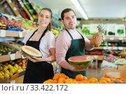 Cheery woman and man holding half of watermelon. Стоковое фото, фотограф Яков Филимонов / Фотобанк Лори