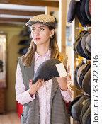 Woman trying on hat during shopping. Стоковое фото, фотограф Яков Филимонов / Фотобанк Лори