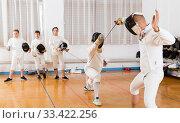 Купить «fencers watching at fencing duel», фото № 33422256, снято 30 мая 2018 г. (c) Яков Филимонов / Фотобанк Лори