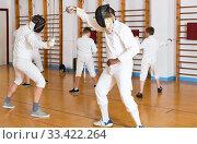 Купить «fencers exercising attack movements in duel», фото № 33422264, снято 30 мая 2018 г. (c) Яков Филимонов / Фотобанк Лори