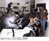 Купить «Photo of motobike with equipment in the store.», фото № 33422508, снято 1 сентября 2017 г. (c) Яков Филимонов / Фотобанк Лори