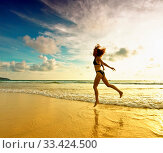 Jumping girl at the beach in the sunset rays. Стоковое фото, фотограф Zoonar.com/Dmitry Kushch / age Fotostock / Фотобанк Лори