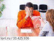 Купить «Young man meeting with advocate in pre-trial detention», фото № 33425936, снято 20 мая 2019 г. (c) Elnur / Фотобанк Лори