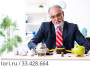 Купить «Old male accountant in budget planning concept», фото № 33428664, снято 12 сентября 2019 г. (c) Elnur / Фотобанк Лори
