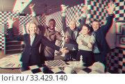 Купить «Colleagues having fun in escape room», фото № 33429140, снято 29 января 2019 г. (c) Яков Филимонов / Фотобанк Лори