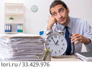 Купить «Young male businessman employee unhappy with excessive work», фото № 33429976, снято 10 сентября 2019 г. (c) Elnur / Фотобанк Лори