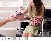 Купить «Man making marriage proposal to disabled woman on wheelchair», фото № 33431408, снято 10 апреля 2017 г. (c) Elnur / Фотобанк Лори