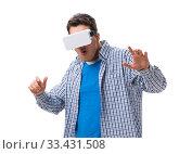 Купить «Young man wearing virtual reality VR glasses», фото № 33431508, снято 27 мая 2017 г. (c) Elnur / Фотобанк Лори