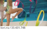 Купить «Young girls teenagers giving a performance at the rhythmic gymnastics tournament using colorful ribbons», видеоролик № 33431748, снято 27 мая 2020 г. (c) Константин Шишкин / Фотобанк Лори