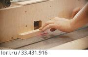 Купить «Carpentry working - hands of man worker make a hemisphere cutout in the plywood», видеоролик № 33431916, снято 2 июня 2020 г. (c) Константин Шишкин / Фотобанк Лори