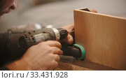 Купить «Carpentry working - man worker drilling the holes in plywood», видеоролик № 33431928, снято 2 июня 2020 г. (c) Константин Шишкин / Фотобанк Лори