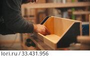 Купить «Carpentry working - hands of man worker making a wooden construction», видеоролик № 33431956, снято 2 июня 2020 г. (c) Константин Шишкин / Фотобанк Лори