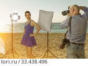 Professional photo shooting outdoors. Attractive female model po. Стоковое фото, фотограф Яков Филимонов / Фотобанк Лори