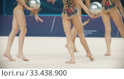 Купить «RUSSIA, KAZAN 12-03-2020, Kazan Stars Open: Young women giving a performance at the rhythmic gymnastics tournament using balls», видеоролик № 33438900, снято 27 мая 2020 г. (c) Константин Шишкин / Фотобанк Лори