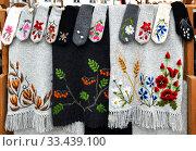 Купить «Knitted wool wares and scarves with embroidery. Tallinn, Estonia», фото № 33439100, снято 21 сентября 2019 г. (c) Валерия Попова / Фотобанк Лори