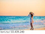 Купить «Woman laying on the beach enjoying summer holidays looking at the sea», фото № 33439240, снято 3 апреля 2017 г. (c) Дмитрий Травников / Фотобанк Лори
