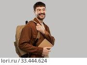 Купить «smiling young man with backpack and diary», фото № 33444624, снято 22 февраля 2020 г. (c) Syda Productions / Фотобанк Лори
