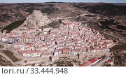 Купить «Aerial view of impregnable fortress in medieval village Morella, Spain», видеоролик № 33444948, снято 10 марта 2019 г. (c) Яков Филимонов / Фотобанк Лори