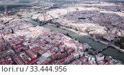 Купить «Aerial panoramic view of modern cityscape of Seville with Guadalquivir river, Spain», видеоролик № 33444956, снято 19 апреля 2019 г. (c) Яков Филимонов / Фотобанк Лори