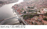 Купить «Day aerial cityscape of Porto city in Portugal», видеоролик № 33445072, снято 17 июня 2019 г. (c) Яков Филимонов / Фотобанк Лори