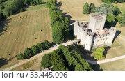 Купить «Aerial view of Chateau de Roquetaillade, medieval castle in commune of Mazeres in Gironde departement, France», видеоролик № 33445096, снято 18 июля 2019 г. (c) Яков Филимонов / Фотобанк Лори