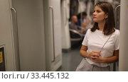 Купить «Portrait of young woman standing in underground carriage», видеоролик № 33445132, снято 19 сентября 2019 г. (c) Яков Филимонов / Фотобанк Лори