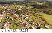 Купить «Autumnal aerial landscape of czech village Ostrov u Macochy in autumn day», видеоролик № 33445224, снято 16 октября 2019 г. (c) Яков Филимонов / Фотобанк Лори