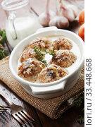Купить «Тефтели  с рисом в молочном соусе на столе», фото № 33448668, снято 17 января 2020 г. (c) Надежда Мишкова / Фотобанк Лори