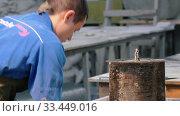 Concrete workshop - the master in blue costume pouring concrete into a round special form. Стоковое видео, видеограф Константин Шишкин / Фотобанк Лори