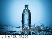 Купить «Clear water splashing near translucent plastic bottle», фото № 33449300, снято 24 октября 2019 г. (c) Гурьянов Андрей / Фотобанк Лори