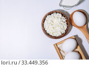 Купить «Food is a source of calcium, magnesium, protein, fats, carbohydrates, balanced diet. Dairy products on the table: cottage cheese, sour cream, milk, chicken egg, contain casein, albumin, globulin, free lactose», фото № 33449356, снято 14 декабря 2019 г. (c) Светлана Евграфова / Фотобанк Лори