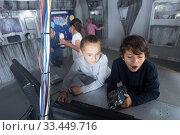 Купить «Children playing in bunker questroom», фото № 33449716, снято 21 октября 2017 г. (c) Яков Филимонов / Фотобанк Лори