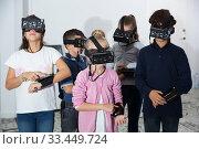 Купить «Children play virtual quest room», фото № 33449724, снято 21 октября 2017 г. (c) Яков Филимонов / Фотобанк Лори