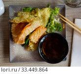 Купить «Fried vegetable tempura served with lettuce and sauce», фото № 33449864, снято 16 июля 2020 г. (c) Яков Филимонов / Фотобанк Лори