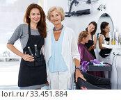 Купить «Smiling woman with stylist», фото № 33451884, снято 26 июня 2018 г. (c) Яков Филимонов / Фотобанк Лори
