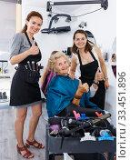 Купить «Hairstylists and satisfied female customer after haircut», фото № 33451896, снято 26 июня 2018 г. (c) Яков Филимонов / Фотобанк Лори
