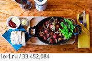 Купить «Polish sausages fried in onions», фото № 33452084, снято 3 июня 2020 г. (c) Яков Филимонов / Фотобанк Лори