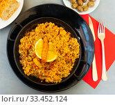 Купить «Paella with seafood – traditional Spanish dish», фото № 33452124, снято 6 июля 2020 г. (c) Яков Филимонов / Фотобанк Лори